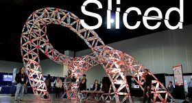 Sliced logo over a structure made using the TrussFormer platform. Original photo via the Hasso-Plattner Institute