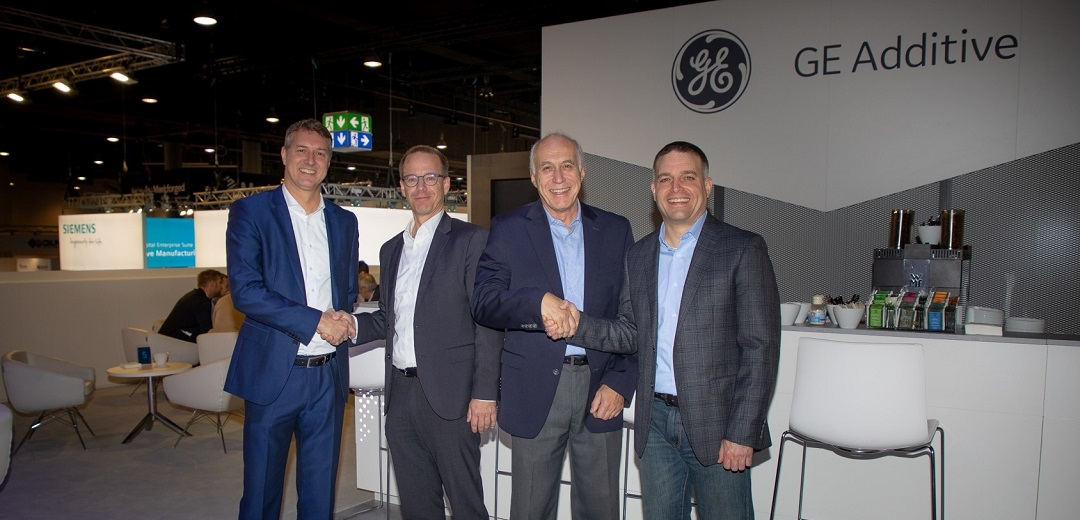 (L-R) Jason Oliver, President and CEO of GE Additive; Karsten Heuser, Vice President Additive Manufacturing, and Andreas Saar, Vice President, Manufacturing Engineering, Siemens; Lars Bruns, Executive Software Leader, GE Additive