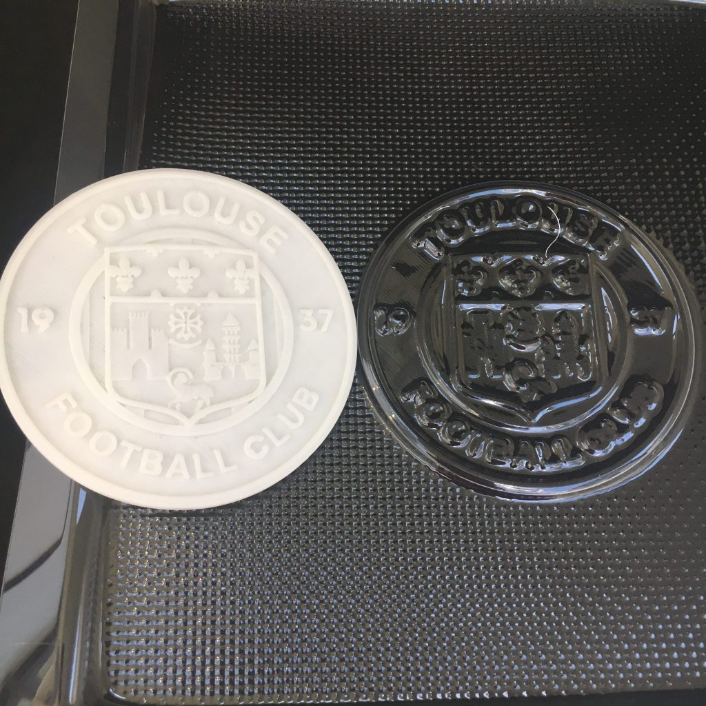 Vacuum formed PETG mold of the Toulouse Football Club emblem and its 3D printed counterpart.