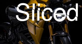 Sliced logo over the Samsung and Energica Bolid-E motorcycle. Original photo via Energica.