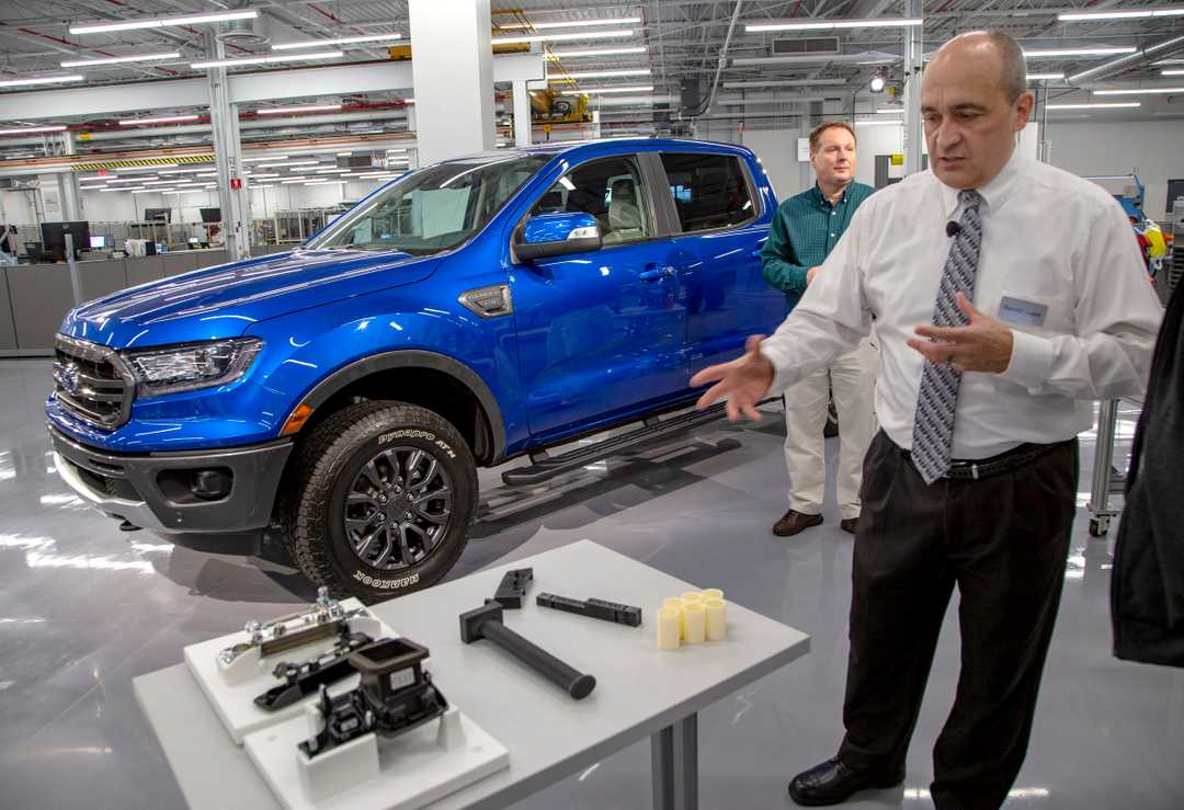 Harold Sears showing the 3D printed parts at Ford's Advanced Manufacturing Center. Photo courtesy of Mandi Wright, Detroit Free Press