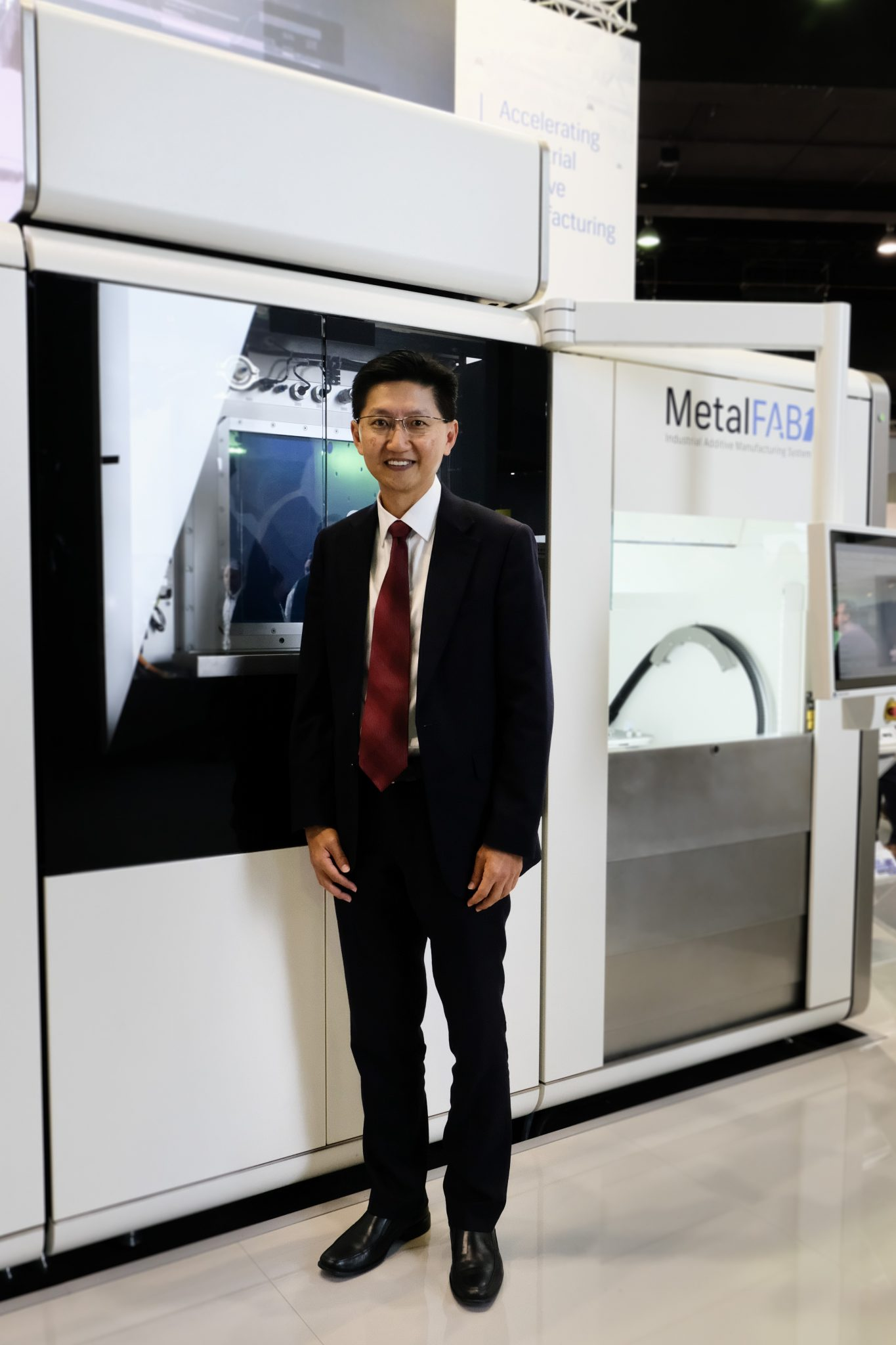 Mike Goh with a MetalFab1 system. Image via Additive Industries.