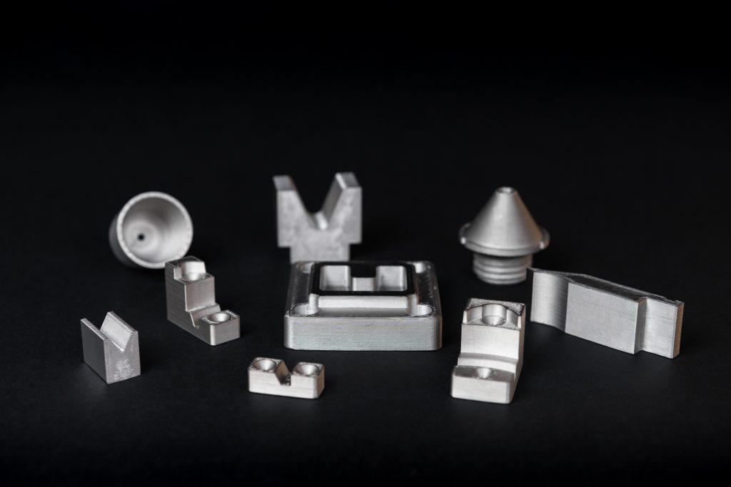 Range of 3D printed H13 tool steel parts. Photo via Markforged