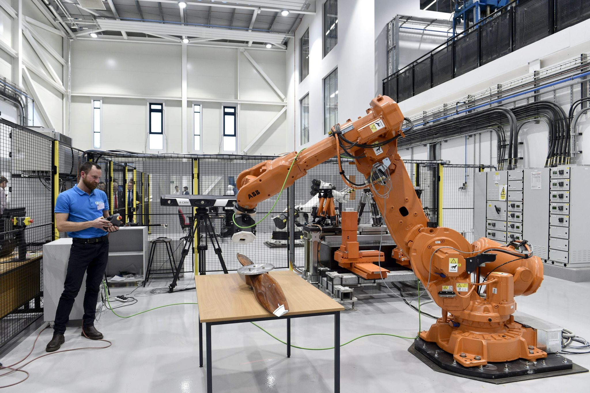 Robots at work in the Centre for Aerospace Manufacturing (CfAM) housed within the AMB. Photo via the University of Nottingham.
