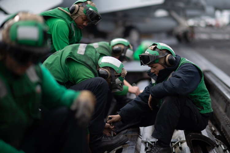 Sailors working on flight operations on the John C. Stennis Carrier. Photo via the U.S. Navy.