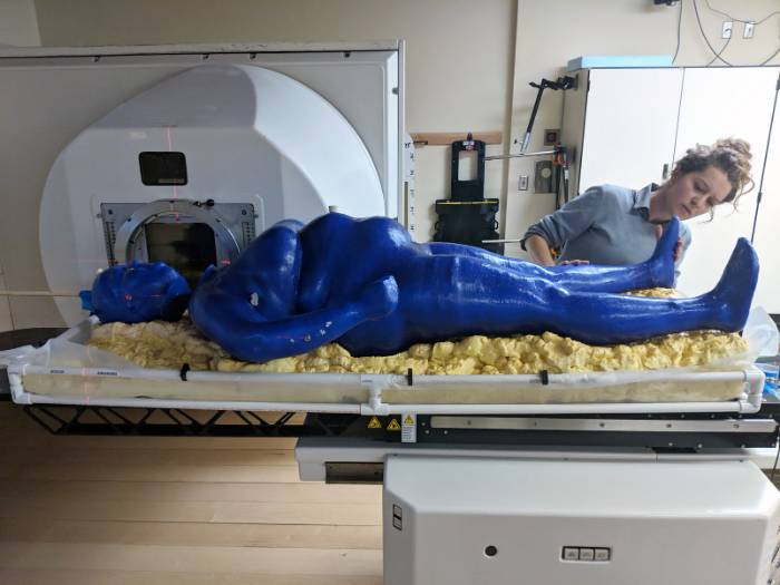 Meagan Moore with the full body 3D printed phantom. Image via Louisiana State University.