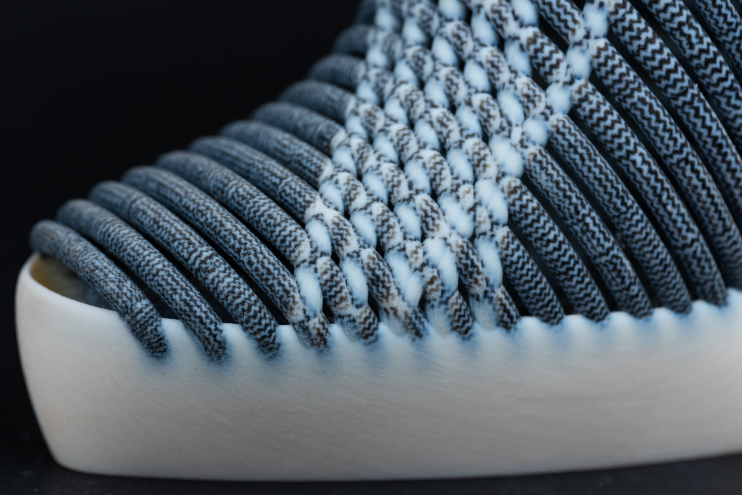 Details of the shoe made by combining 3D printing and ikat weaving. Image via Ganit Goldstein.