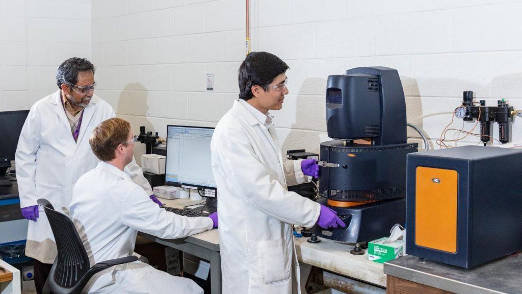 ORNL scientists testing lignin materials. Photo via Oak Ridge National Laboratory