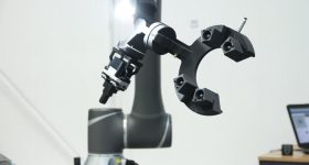 End-of-arm tooling produced on the Fortus 380CF in action on a robotic arm. Photo via SYS.