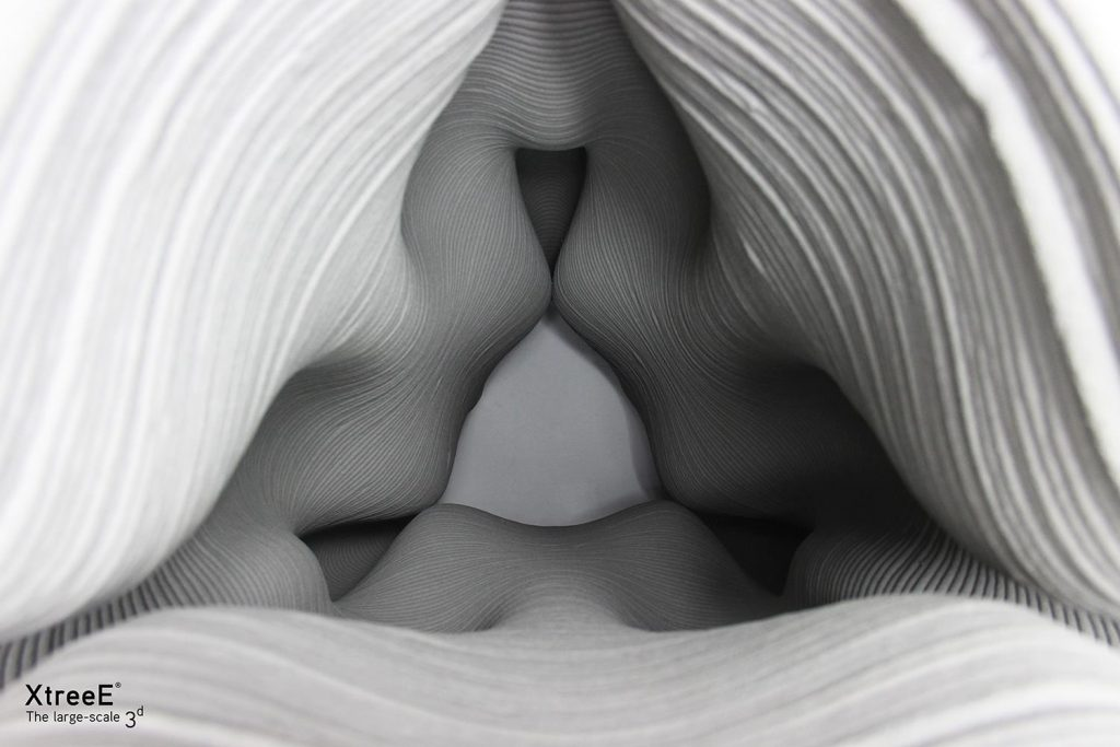 Cement structure 3D printed by XtreeE. Photo via XtreeE