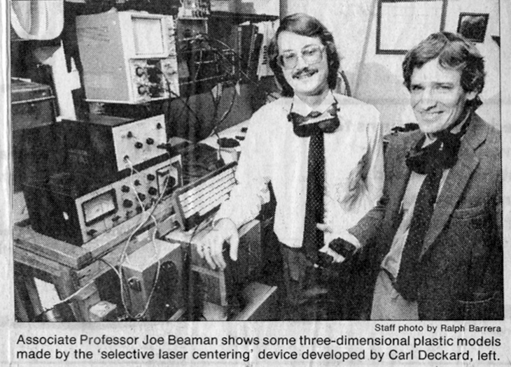 Newspaper clipping picturing Dr. Joseph Beaman and Dr. Carl Deckard on the invention of SLS 3D printing. Image via me.utexas.edu