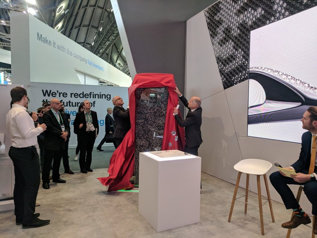 Dr. Adrian Keppler, CEO at EOS, unveils the LaserProFusion demonstrator at Formnext 2018. Photo by Michael Petch.