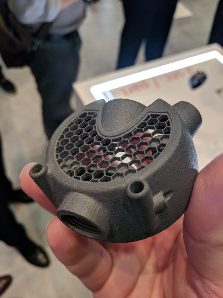 Honeycomb-topped cap sample component from the LaserProFusion. Photo by Michael Petch