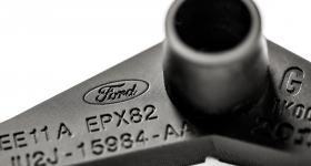 A Ford Focus HVAC Lever Arm Service Part. Photo via Carbon.