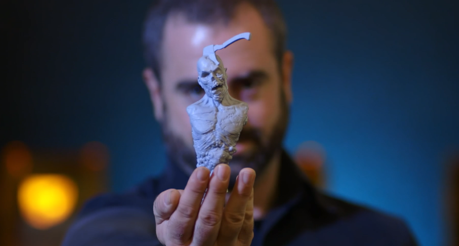 Jared Krichevsky, a character and creature designer, holding a 3D printed character created using the Scan-to-sculpt-to-print workflow. Photo via Formlabs.
