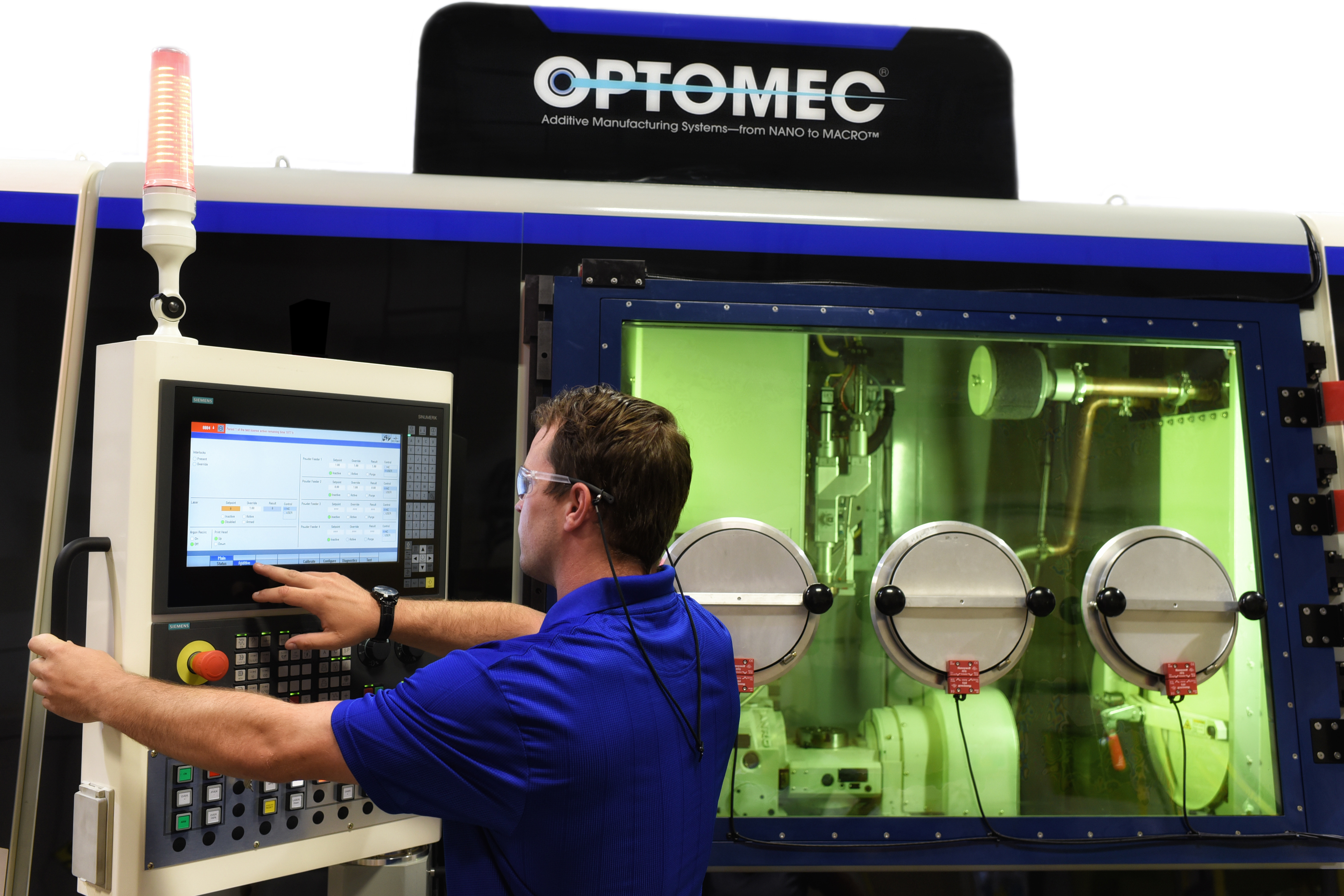 The Optomec LENS 860 closed atmosphere hybrid additive manufacturing system. Photo via Optomec