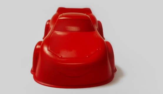 Prototypes of the miniature Lighting McQueen car created from 3D printed metal molds. Photo via Materialise.