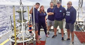 From left: Grady Bolan, Allison Redington, Associate Professor Stephen Licht, Sean Nagle and Josh Allder on the deck of the Okeanos Explorer. Photo via Josh Allder/URI.