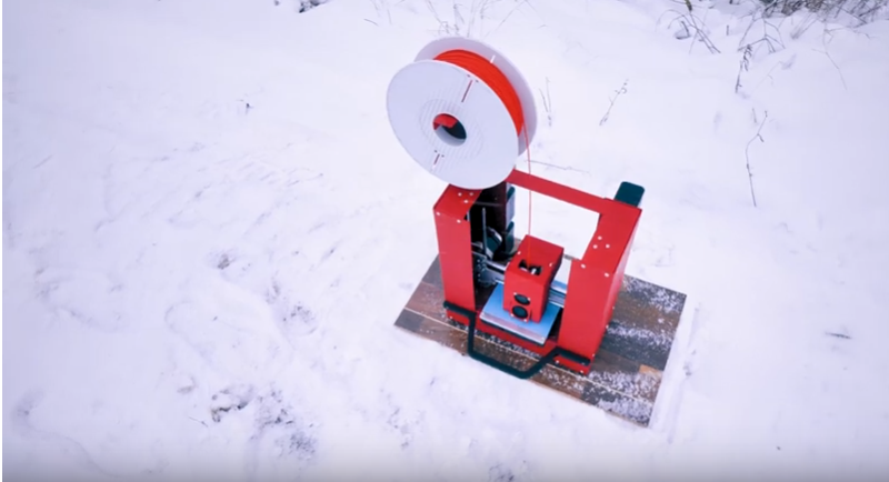 A converted, portable Printrbot Play in the snow. Screencap via Thomas Sanladerer on YouTube.