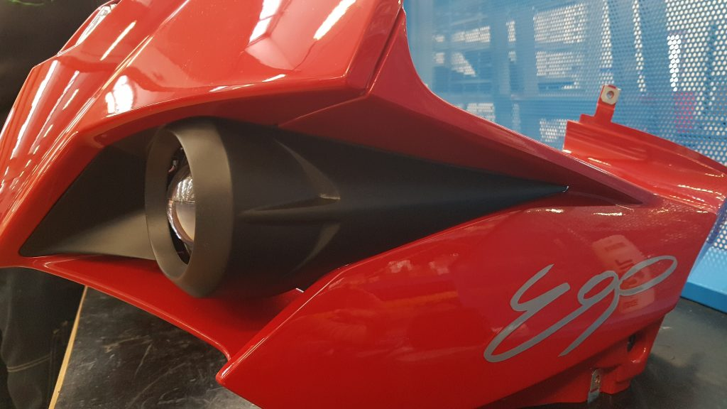 CRP Windform 3D printed electric motor front headlight housings for the Energica Ego Corsa. Photo via CRP Technology