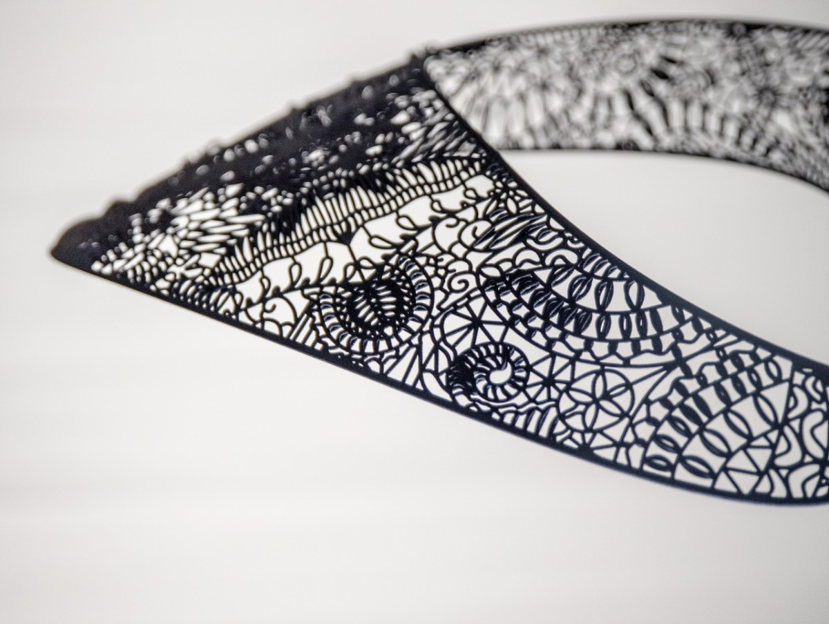 Detail of the filigree design of the 3D-printed statement piece. Photo via Materialise.