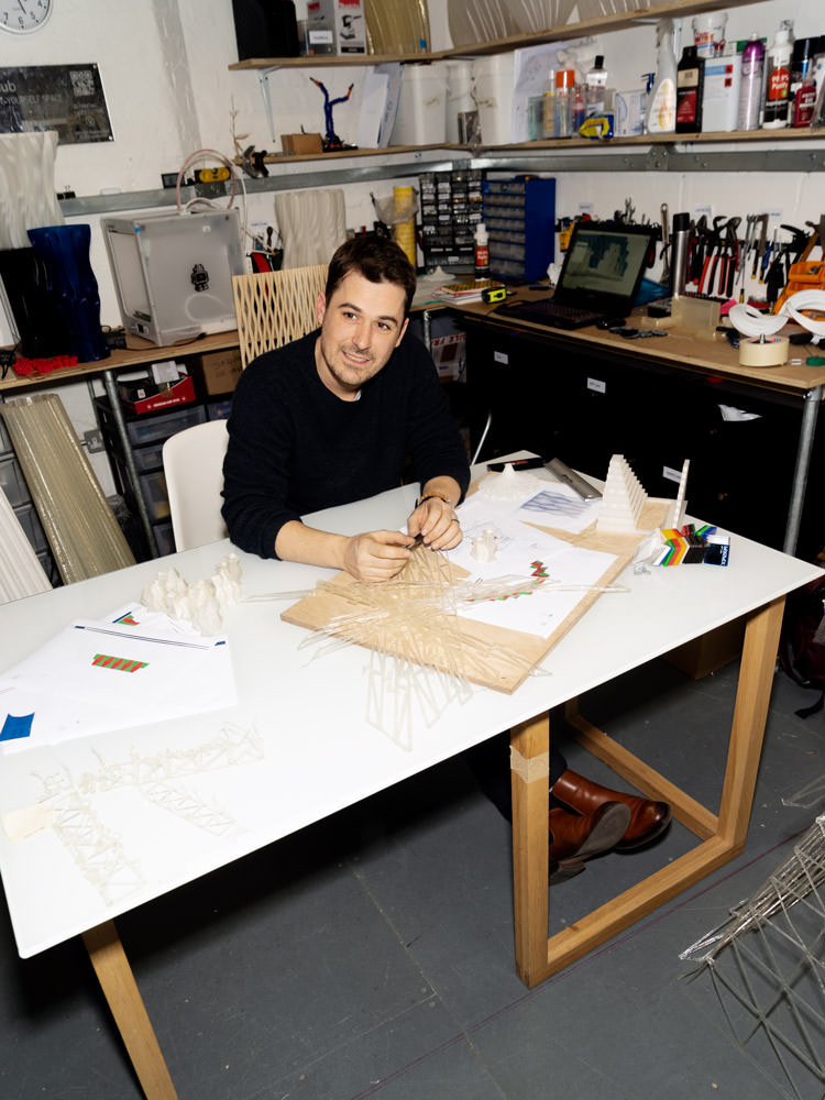 Arthur Mamou-Mani working on the design for the 3D printed installation. Photo via COS.