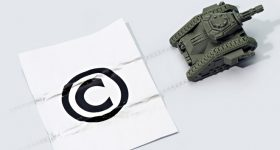 A 3D printed tank next to a copyright symbol. Image via SOURCE3.