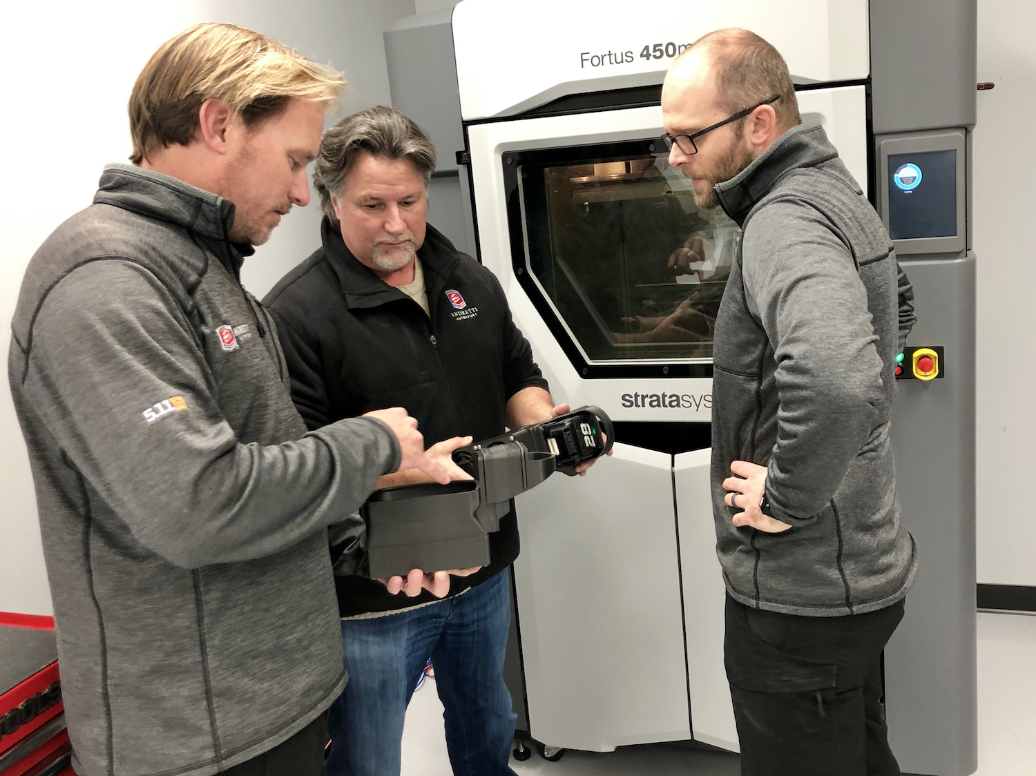 Michael Andretti (middle) with Eric Bretzman, Technical Director and Aaron Marney, Senior Development Engineer of Andretti Autosport. Image via Stratasys.