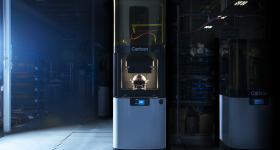 The Riddell SpeedFlex Precision Diamond helmet posed on the Carbon L1 3D printer. Photo via Carbon