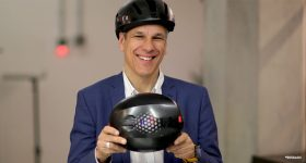 Markus Glasser, SVP of EOS, with the 3D printed Hexo Helmets. Photo via EOS.