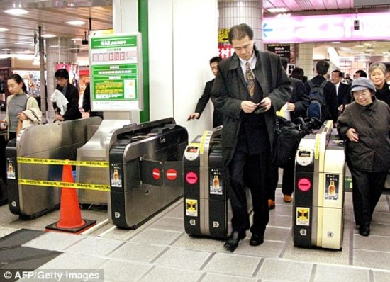 Pedestrians walking on a piezoelectric sheet powers the ticket barrier in a Japanese train station. Photo via AFP/GETTY IMAGES