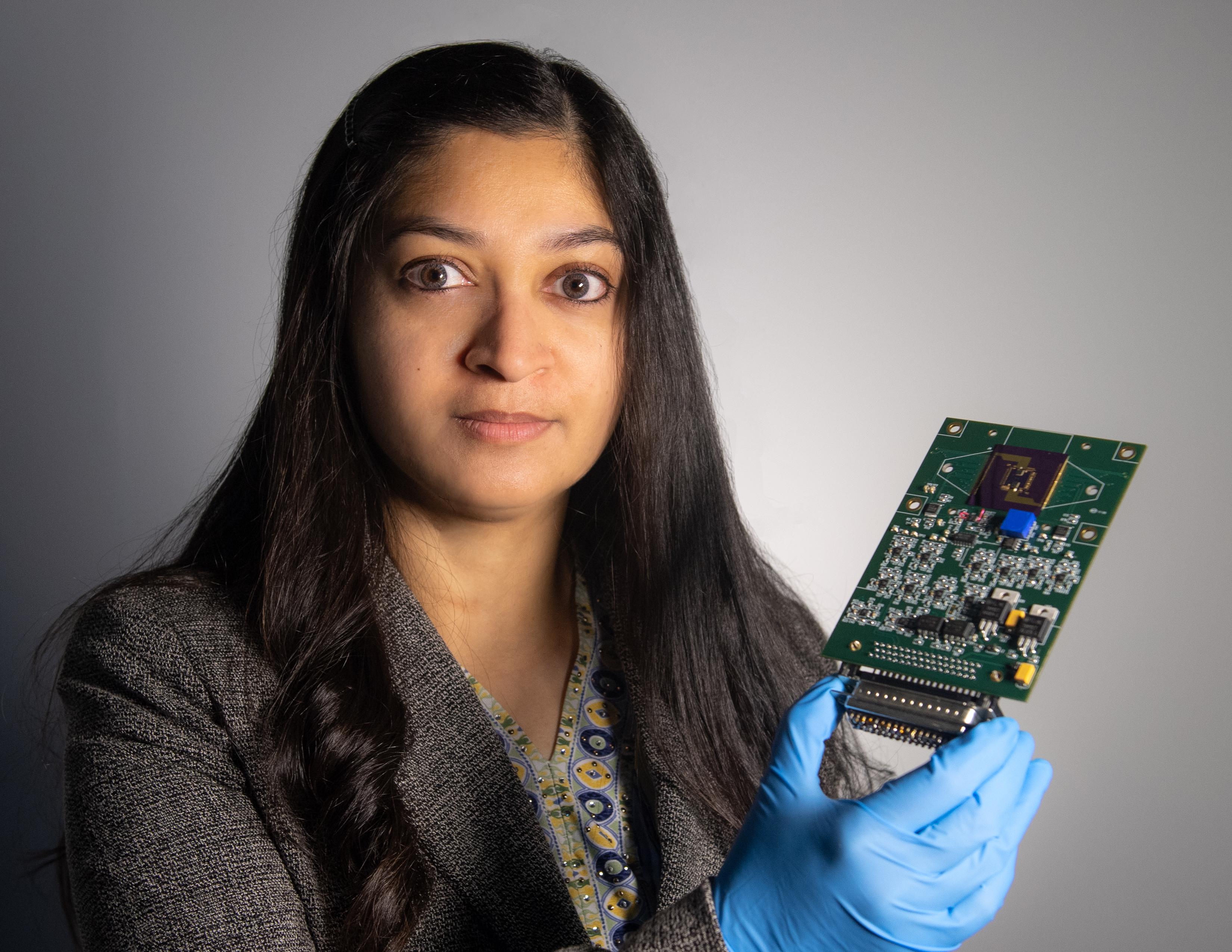 Mahmooda Sultana holding a multifunctional sensor platform. Image via NASA.
