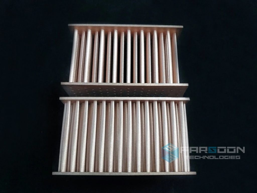 Two 3D printed copper heat exchangers. Image via Farsoon Technologies