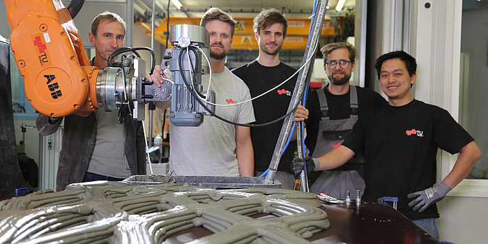 The printing team after the successful printing of the prototype. Photo via TU Graz.