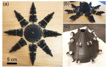 3D die-castings for forming the origami gripper. Image above MIT.