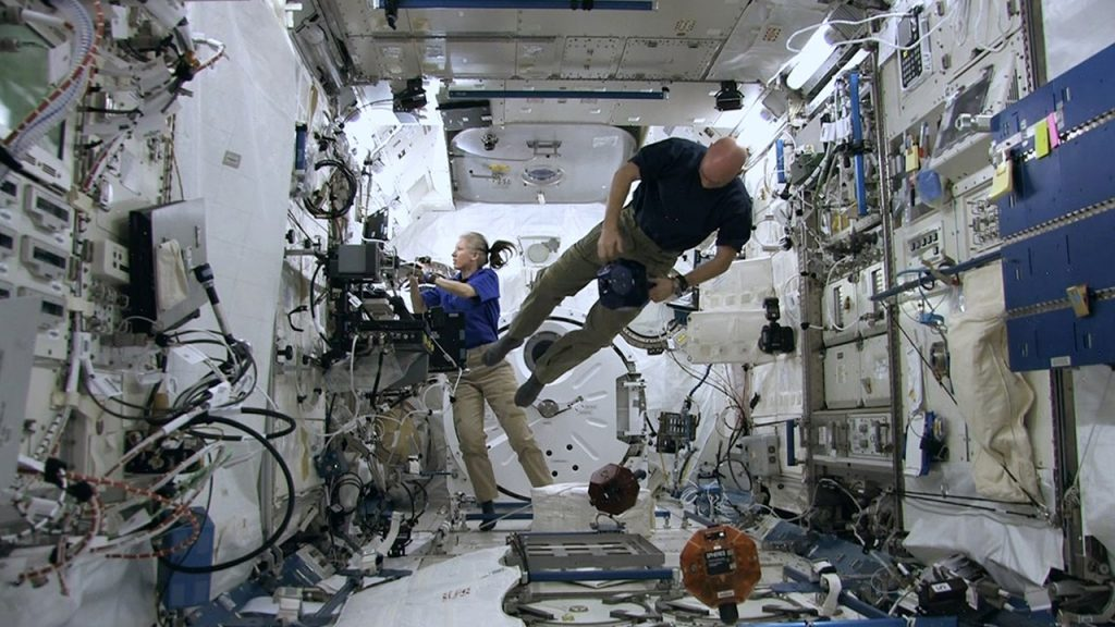 Crew working inside the International Space Station. Photo via NatGeo/ISS: 24/7 ON A SPACE STATION