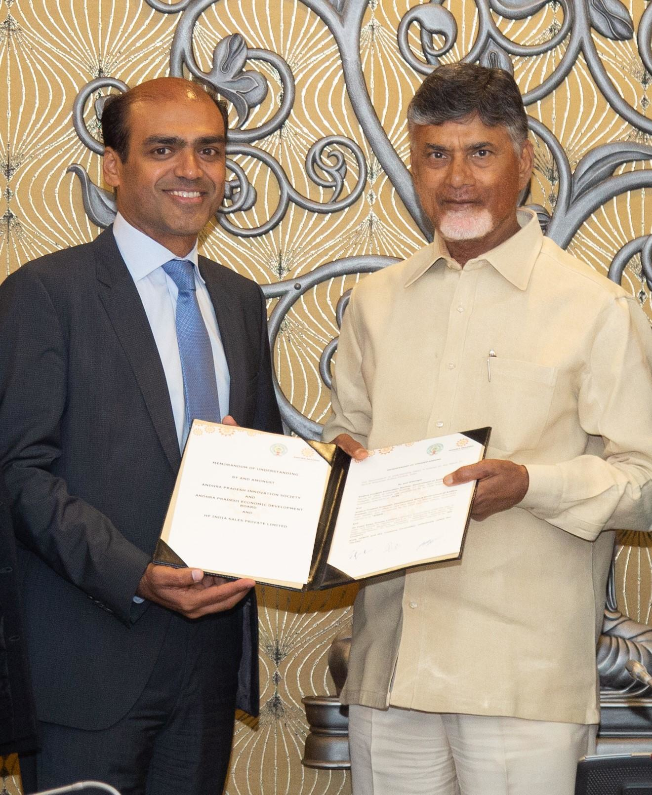 N. Chandrababu Naidu, Chief Minister of Andhra Pradesh (Right) with the signed document. Image via The Economic Times India.