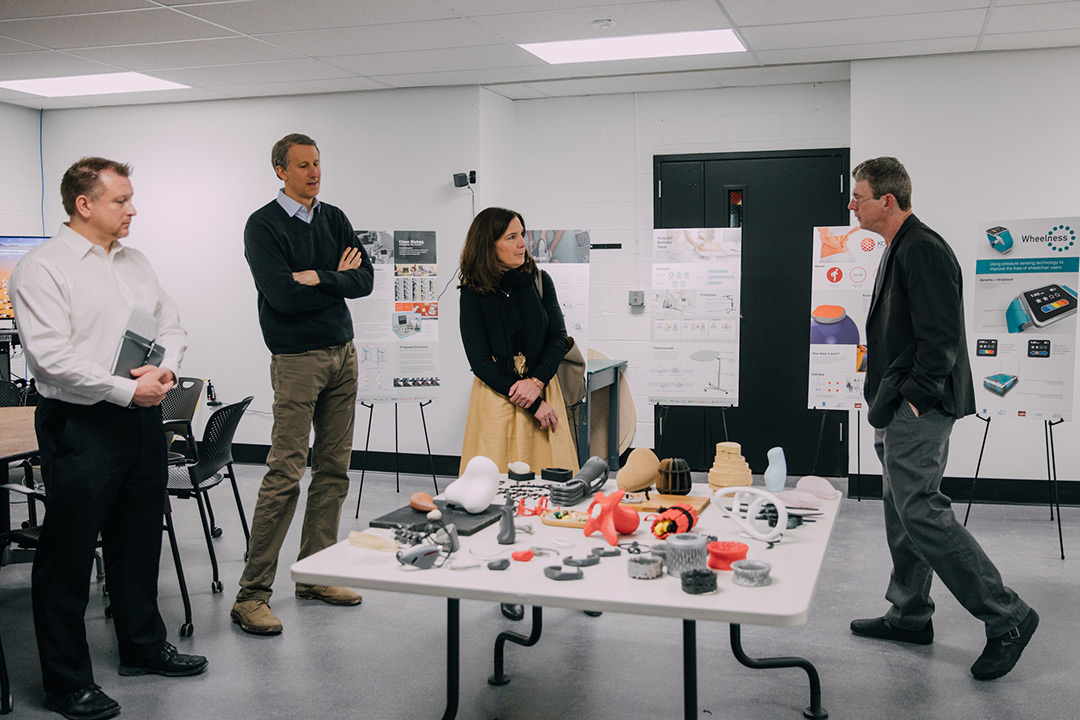 Stan Rickel (right), associate professor of industrial design in the School of Design, speaks with Autodesk executives during the software company's recent visit to RIT. Photo via RIT.