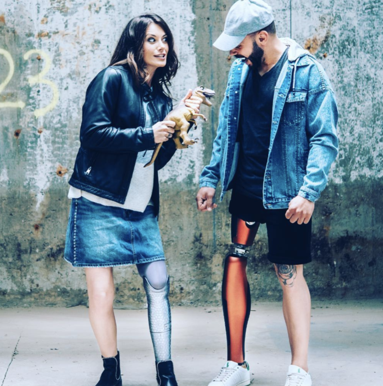 Two models wearing UNYQ's line of 3D printed prosthetics. Photo via UNYQ.