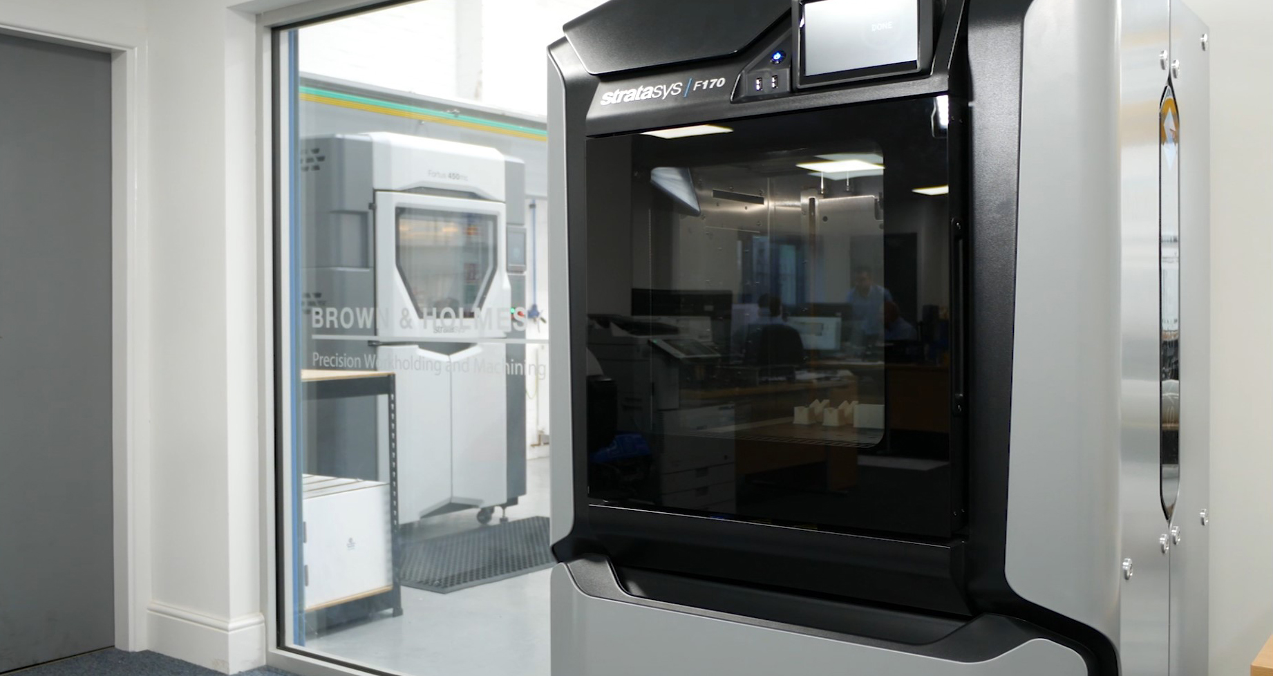 The Stratasys F170 and Fortus 450mc installed on the shop floor at Brown & Holmes. Photo via SYS Systems.