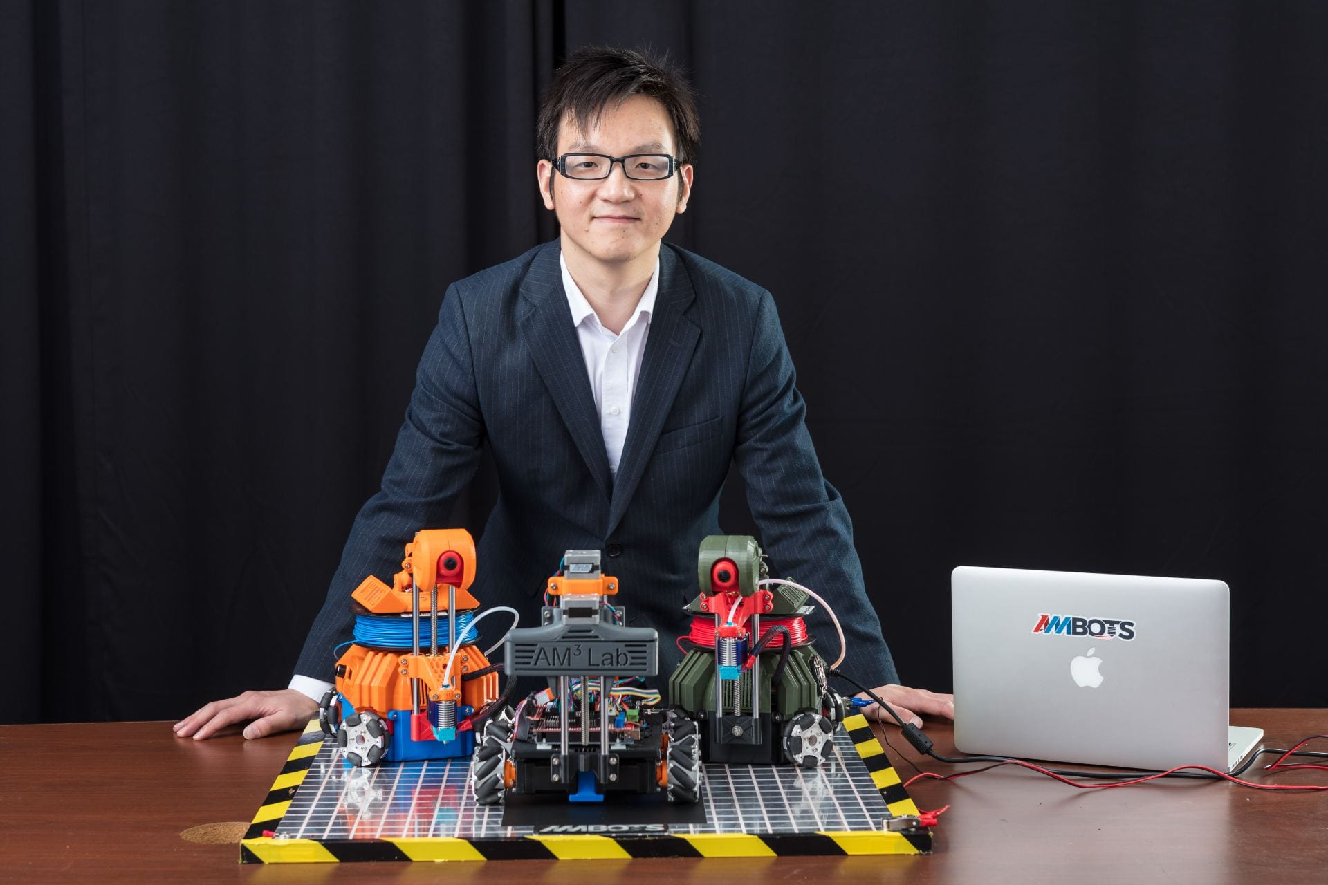 Wenchao Zhou, co-founder of Ambots with mobile 3D printers. Image via Ambots.