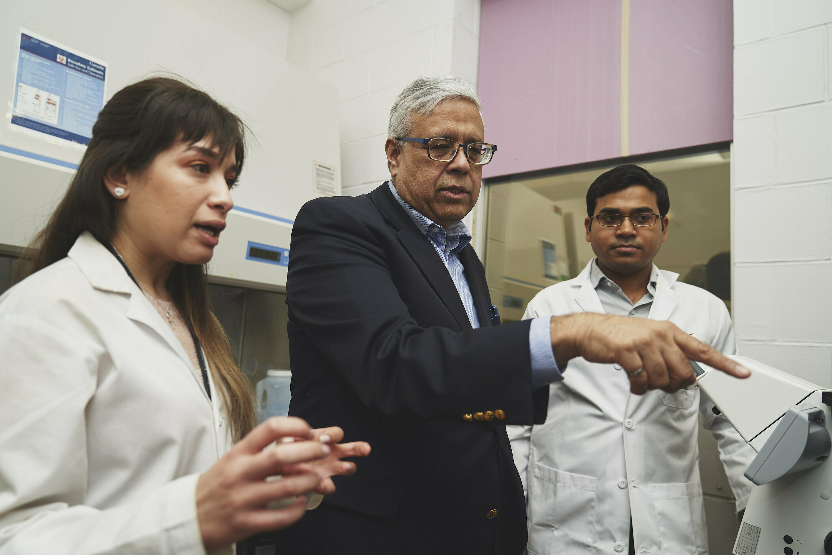 Ishwar Puri, centre, with his research team, Sarah Mishriki, PhD candidate in the School of Biomedical Engineering and lead author, and Rakesh Sahu, a research associate. Photo via Jin Lee, McMaster University, Faculty of Engineering.