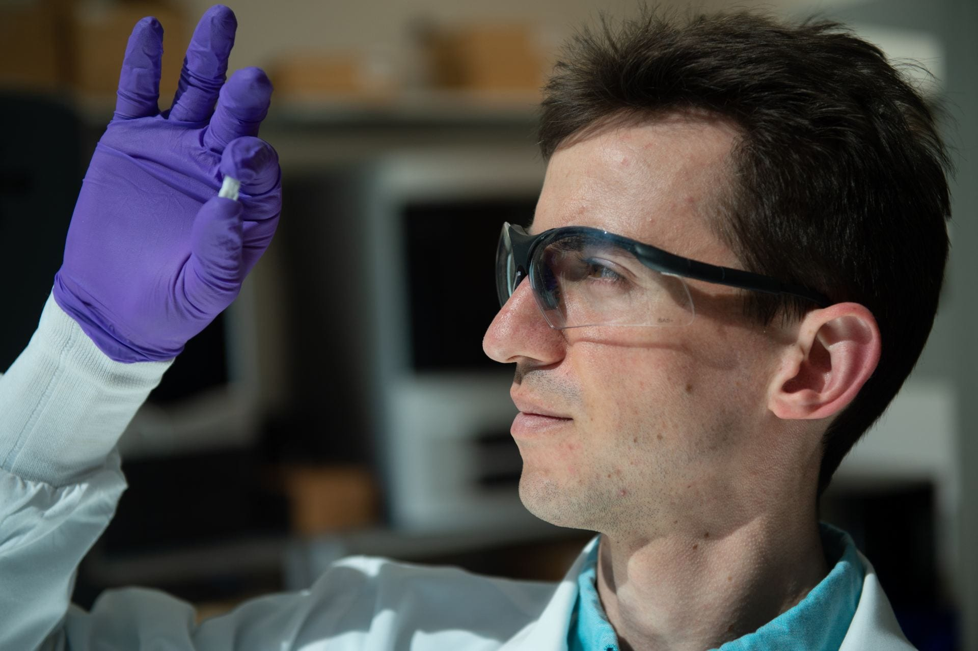 Rice University graduate student Sean Bittner holds a sample of a 3D printed scaffold. Photo by Jeff Fitlow, Rice University