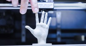A 3D printed hand. Photo via Shutterstock.