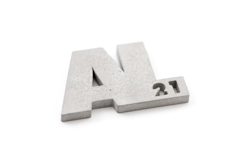 Aluminum symbol and mass 3D printed on a DMLS machine. Image via Materialise.