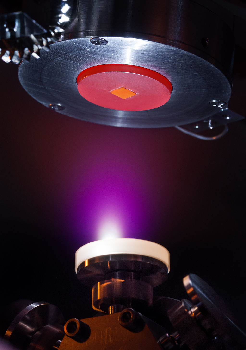 Pulsed laser deposition in action. Photo via Intellegens.