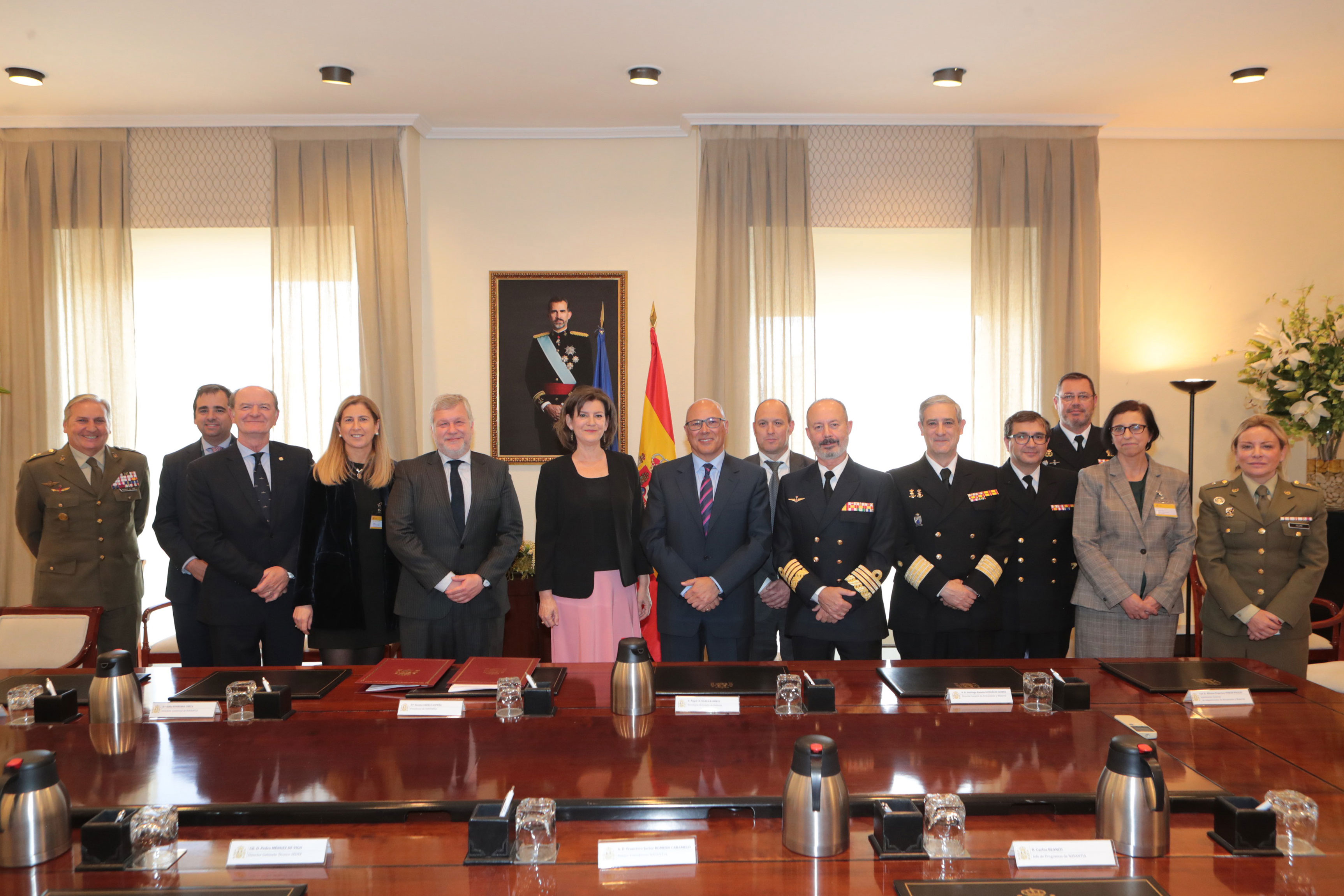 The signing of the contract between heads of both Navantia and the Ministry of Defense. Photo via Navantia.