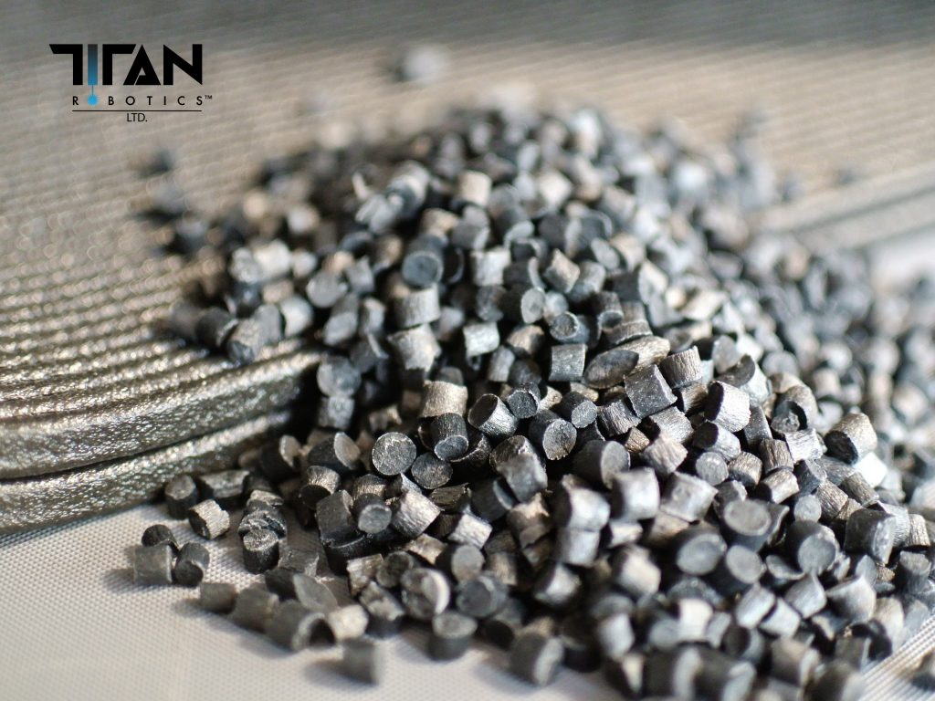 Pelletized feedstock for Titan Robotics' 3D printers. Photo via Titan Robotics