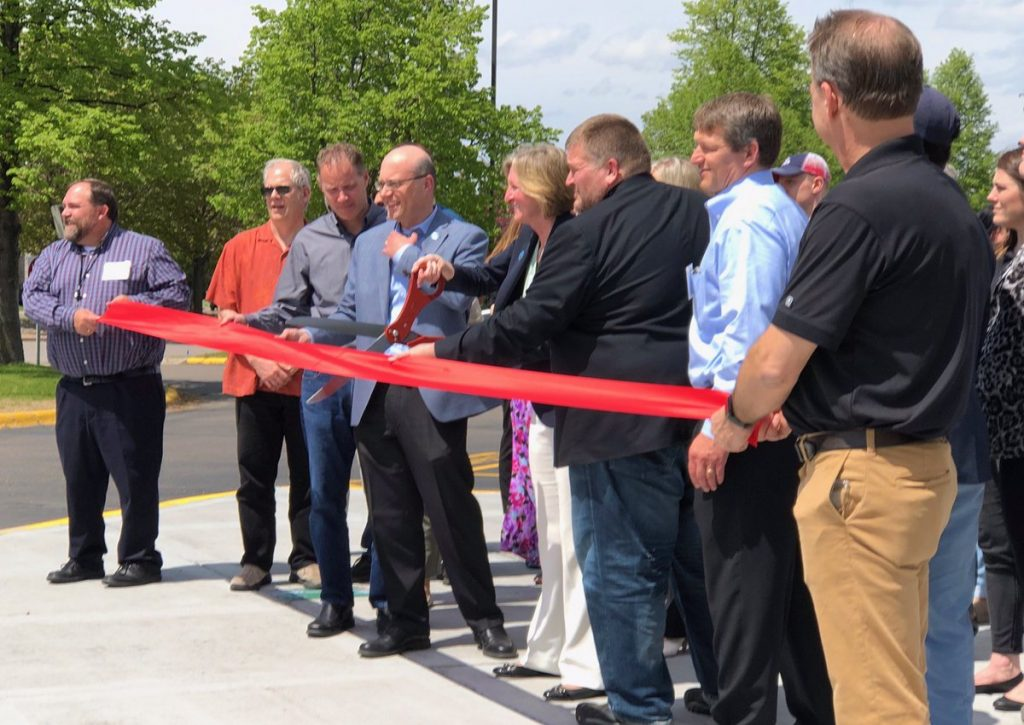 Protolabs President and CEO Vicki Holt cuts the ribbon at the opening of the new Brooklyn Park facility. Photo via Protolabs