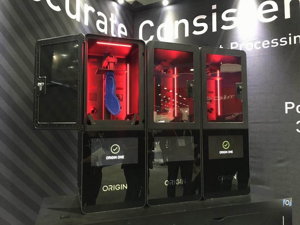 Three Origin One 3D printers at RAPID + TCT 2019. Photo by Beau Jackson